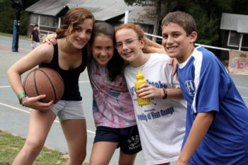 According to a new report, these happy kids at Camp Ramah in the Berkshires are more likely to be Jewishly engaged as adults than their friends who didn't go to Jewish camp.  (Judah S Harris/Foundation for Jewish Camp)