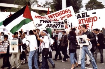 Anti-Israel protesters demonstrate at the 2001 Durban Conference. Jewish leaders say a draft document for the 2009 conference, known as Durban II, has some improvements from an earlier edition but is still insufficient. (Julian Voloj )