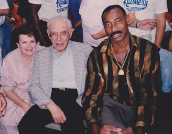 Caption: Milton and Helen Kutsher with Wilt Chamberlain, who was a bellman at the Kutshers' resort in the Catskills before moving on to a Hall of Fame basketball career.  (Courtesy of Kutsher's Country Club)