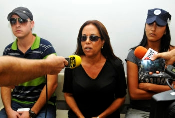 Low note: Margalit Tzanani, the popular Israeli singer known as Margol, takes questions at the Petach Tikvah District Court, August 2011. Tzanani is suspected of blackmail, extortion, conspiracy and obstruction of justice.  (Yossi Zeliger/Flash 90)