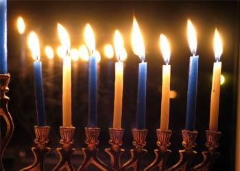 JewMama, JTA's family living columnist, explores whether lighting the menorah or exchanging presents be more of the focus on Chanukah. (Chaim Zvi / Creative Commons)