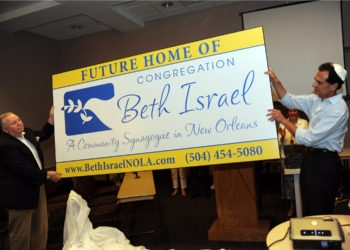 Congregation Beth Israel President Myron Goldberg, left, and Richard Katz unveil a sign announcing Beth Israel's building project in a ceremony on Aug. 30, 2009. (Alexander Barkoff)