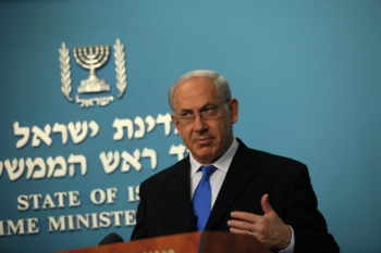 Signs show that Israeli Prime Minister Benjamin Netanyahu, speaking Nov. 29, 2009 during a news conference in his Jerusalem office, and President Obama are very much on the same page concerning Iran sanctions. (Yossi Zamir / Flash 90 / JTA)
