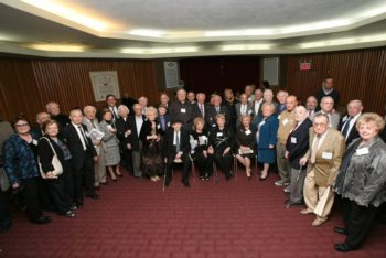 Partisans posing at a reception at Manhattan's Park East Synagogue launching a 24-hour celebration of their World War II heroism, Nov. 6, 2011. (Courtesy of Jewish Partisan Educational Foundation)