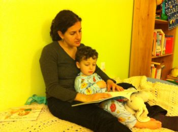 Dasee Berkowitz practicing her reading and storytelling skills with son Tamir.  (Courtesy Dasee Berkowitz)