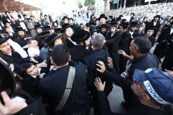 Young haredi men clash with police in the Israeli city of Beit Shemesh, Dec. 26, 2011. (Kobi Gideon / Flash90)