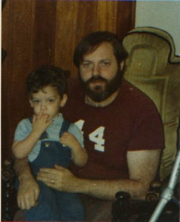 Sam Goldstein, shortly before he died of complications from the swine flu vaccine in 1977, holds son Craig on his lap. (Courtesy of the Goldstein Family)