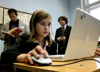 Christina, 11, uses a computer during math class at School No. 550, an ORT school in St. Petersburg. (Grant Slater)