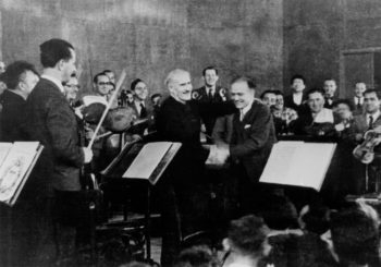 "Arturo Toscanini, left, and Bronislaw Huberman on stage after the first Palestine Symphony concert in 1936, as seen in ""Orchestra of the Exiles,"" a film by Josh Aronson. (Courtesy of the Felicja Music Center Library/Huberman Archive)"