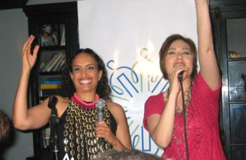 Achinoam Nini, left, and Mira Awad thank supporters at a Tel Aviv bar at a send-off party on April 30, 2009 ahead of their performance in the Eurovision Song Contest. (Dina Kraft)