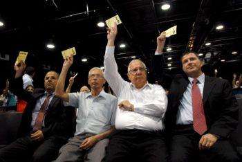 Among the new proponents of a one-state solution is Knesset Speaker Reuven Rivlin, in white long-sleeved shirt voting at a Likud Party meeting, June 24, 2010.  (Gili Yaari / Flash90 / JTA)