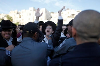 Orthodox Jews protesting against the Women of the Wall prayers in the Western Wall in Jerusalem, May 10, 2013. (Flash90)