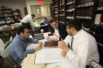 Jordan Soffer (YCT '16) learns with Rabbi Shmuly Yanklowitz (YCT '10) and Rabbi Eytan Yammer (YCT '11) in the Beit Midrash.