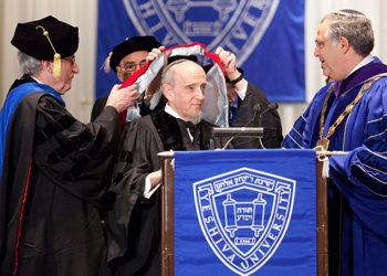 As Yeshiva University tallied its damage from the Bernard Madoff scandal, its president, Richard Joel, right, bestowed an honorary doctorate on Rabbi Haskel Lookstein on Dec. 14, 2008. (Yeshiva University)