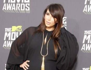 Kim Kardashian walking the red carpet at the 2013 MTV Movie Awards in Los Angeles. (PR Photos)