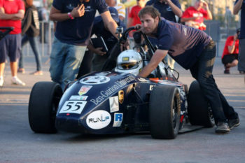 Dror Hazan, right, one of the managers of the Ben-Gurion University Formula project, pushing Rani Dekel, who is driving the race car during the Jerusalem Formula event, June 14, 2013. (Raz Schweitzer/Ben Gurion Racing)