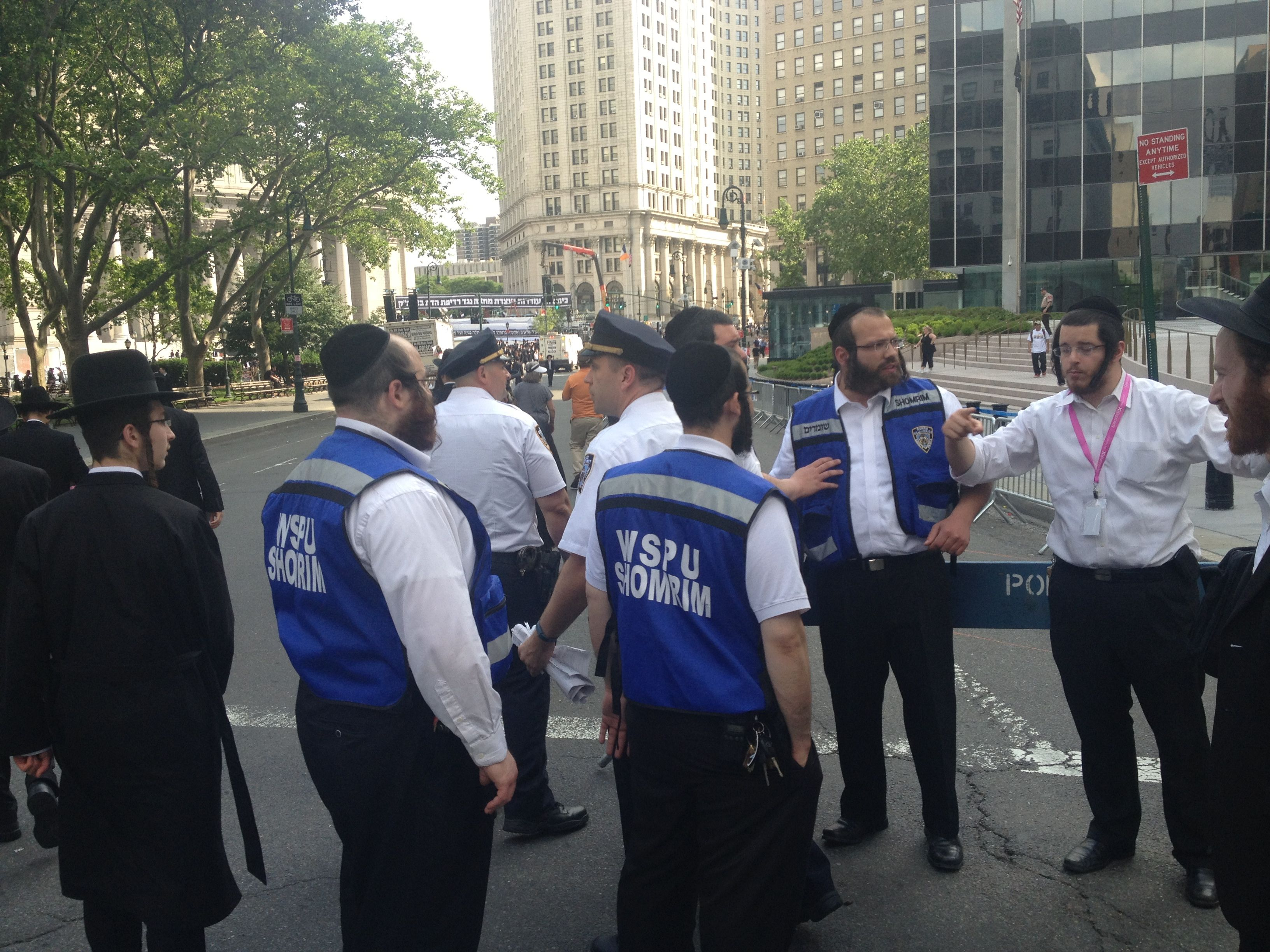Police organize protestors at a rally against the drafting of Israeli haredim in Manhattan, June 9, 2013.