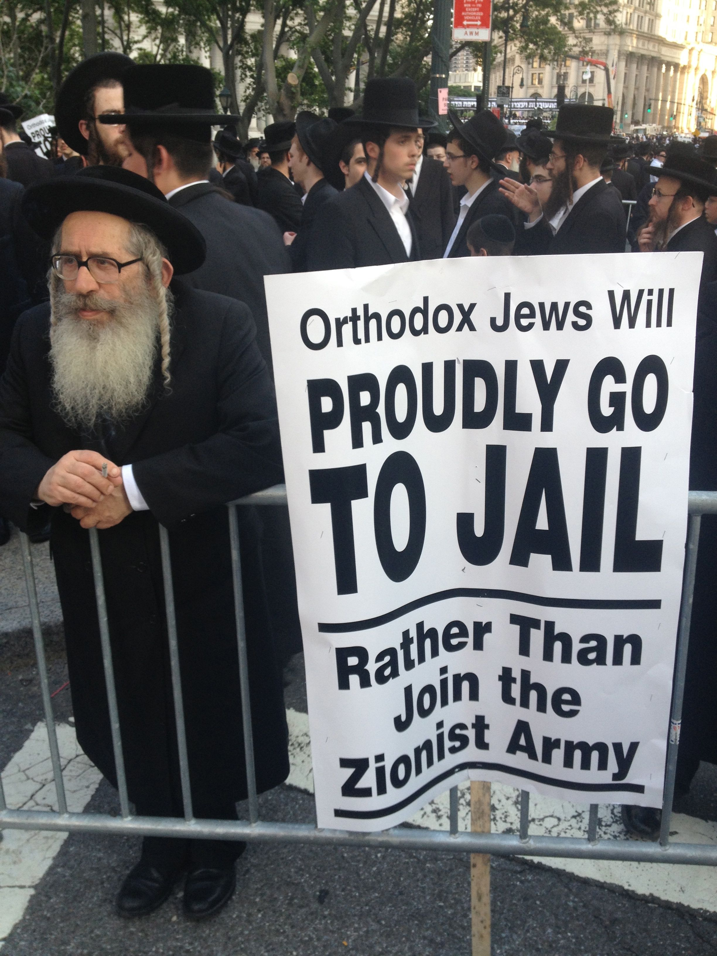 A haredi Orthodox Jew protests the proposed drafting of ultra-Orthodox Israelis in the army.