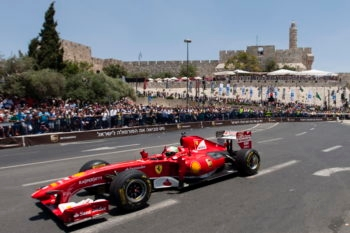 A Formula 1 Ferrari race car driving through the Old City during the Jerusalem Formula Peace Road Show, June 14, 2013. (Flash 90)