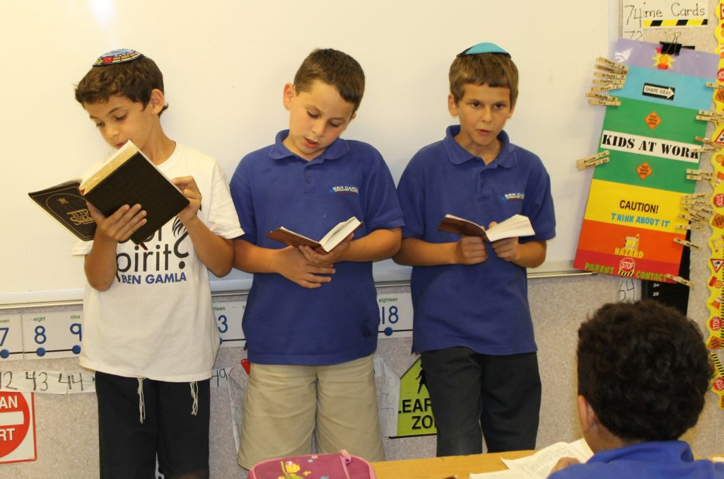 The day at the Jewish Upbringing Matters Program, a religious after-school program serving students at the Ben Gamla Hollywood Hebrew charter school, begins with morning prayers -- even though it's afternoon. (Uriel Heilman)
