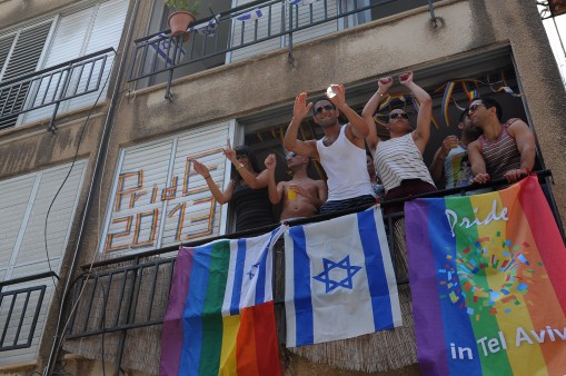 Israelis celebrating the Tel Aviv Gay Pride Parade from their homes, June 7, 2013. (Gili Yaari/Flash90)