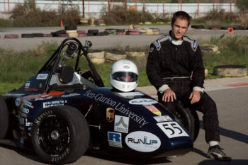 Driver Rani Dekel standing next to the Formula car built by Ben-Gurion University students. (Raz Schweitzer/Ben Gurion Racing)