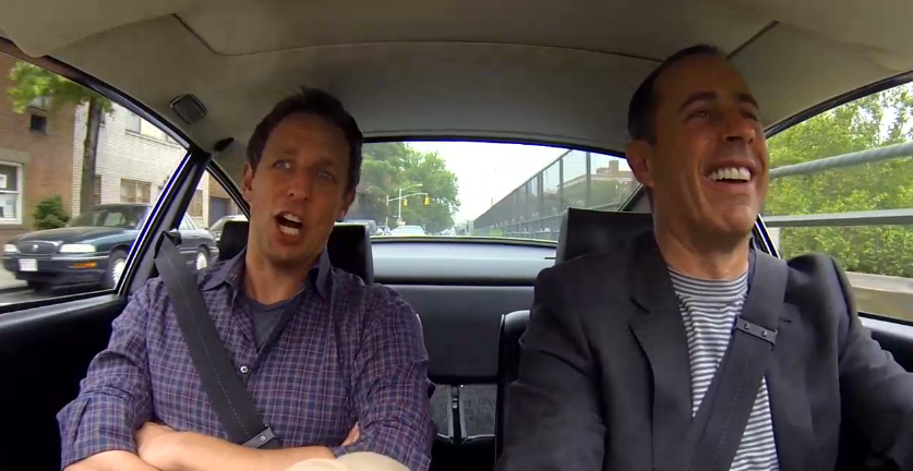 Seth Meyers and Jerry Seinfeld in a car, on their way to get coffee.