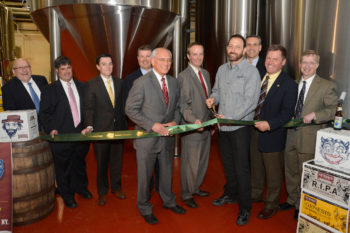 Albany, N.Y., officials joining the brewers of Shmaltz Brewing for the ribbon-cutting ceremony at the company's new facility in suburban Clifton Park, May 13, 2013. (Lisa Klug)