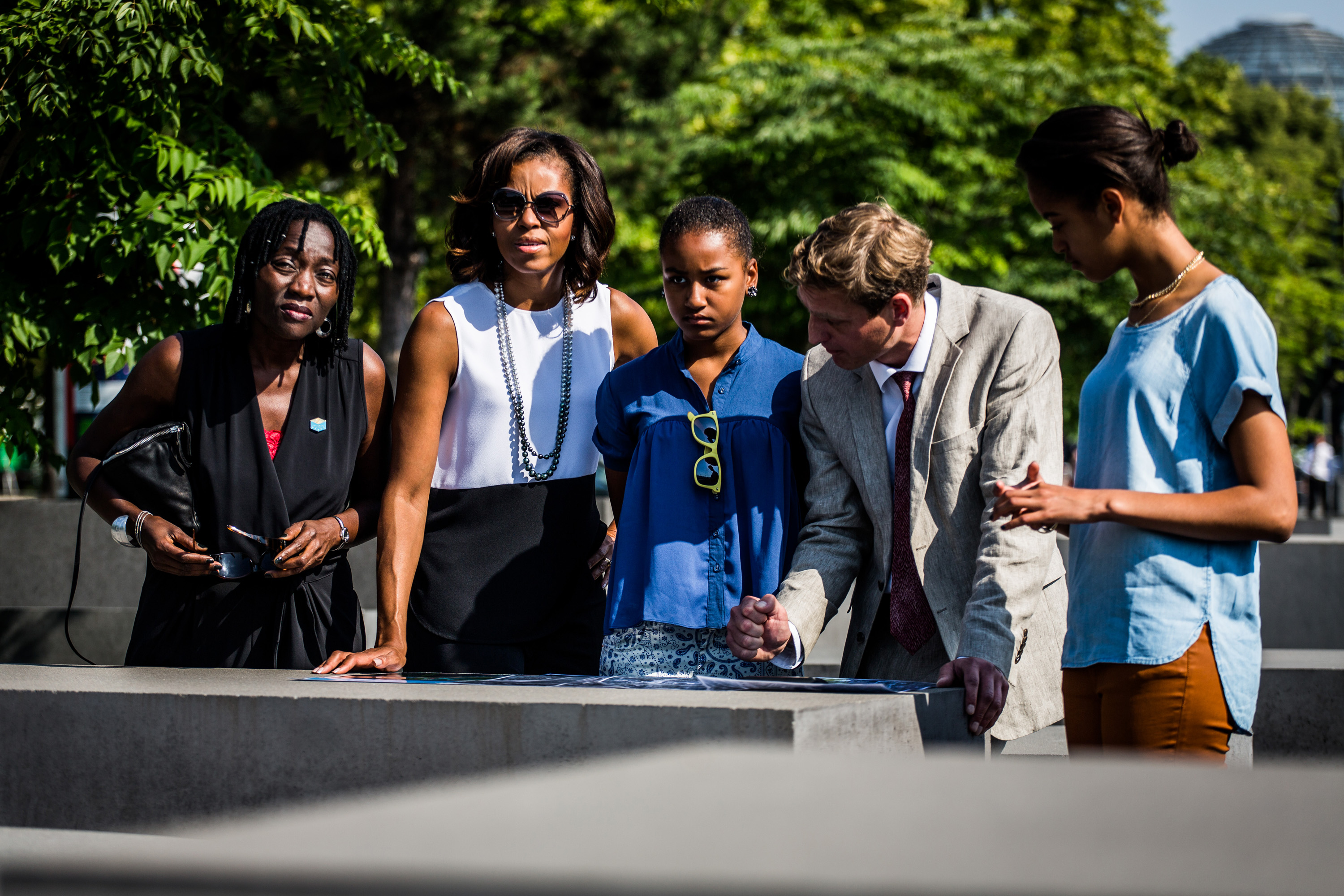 Left to right, President Obama's half-sister Auma Obama; first lady Michelle Obama and her daughter Sacha; Berlin Holocaust memorial director Uwe Neumaerker; and Michele Obama's daughter Malia at the Holocaust memorial, June 19, 2013. (Marco Priske / Stiftung Denkmal)