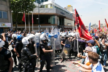 Turkish riot police clashing with protesters near Taksin Square in Isranbul, Turkey, June 11, 2013. (Eser Karadag/Creative Commons)