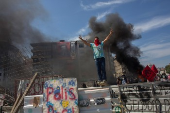 Protester standing on top of a barricade during a demonstration near Taksim Square in Istanbul, Turkey, June 11, 2013. (Lam Yik Fei/Getty)