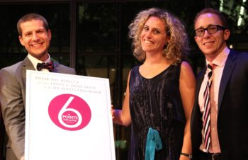 Josh Feldman (left) and Aaron Bisman help honor Rebecca Gruber for her work at the Six Points Fellowship, June 10, 2013. (Shulamit Seidler-Feller)