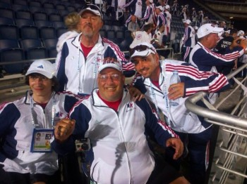 Dave Blackburn, shown at center during last week's opening ceremony, is attending the Maccabiah as a paralympian in table tennis after six previous appearances as an able-bodied softball pitcher. (Courtesy Dave Blackburn)