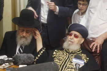 Shas spiritual leader Rabbi Ovadia Yosef, right, congratulating his son, newly elected Sephardic Chief Rabbi Yitzhak Yosef, at Ovadia Yosef's Jerusalem residence, July 24, 2013. (Flash90/JTA)
