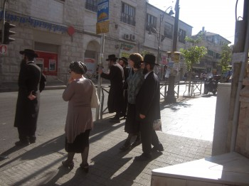 Haredi Orthodox Jews passing through Shabbat Square, a central intersection between two Jerusalem haredi neighborhoods.(Ben Sales)