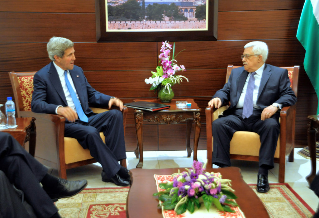 U.S. Secretary of State John Kerry sitting with Palestinian Authority President Mahmoud Abbas before a meeting in Ramallah, West Bank, July 19, 2013. (State Department photo/ Public Domain)
