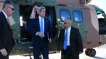 U.S. Secretary of State John Kerry stepping off a helicopter after flying from Amman, Jordan, to Ramallah, West Bank, to meet with Palestinian Authority President Mahmoud Abba, July 19, 2013. (State Department photo/ Public Domain)