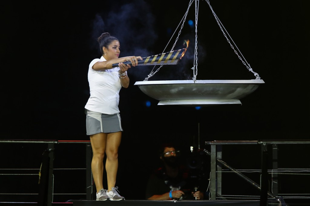 U.S. Olympic gymnast and gold medalist Aly Raisman lighting the torch during the opening ceremony of the 19th Maccabiah Games at Jerusalem's Teddy Stadium, July 19, 2013. (Yonatan Sindel/Flash90/JTA)
