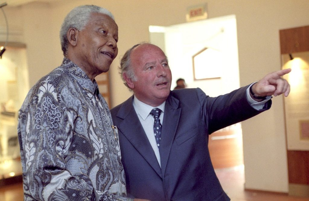 The late philanthropist Mendel Kaplan showing late South Africa President Nelson Mandela around the South African Jewish Museum, which was opened by Mandela in 2000.  (Shawn Benjamin/Ark Images)
