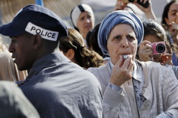 An Orthodox woman blows a whistle in protest against efforts to promote women's prayer at Jerusalem's Western Wall, July 8, 2013. (Miriam Alster/FLASH90)