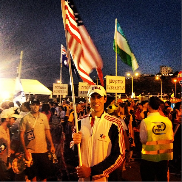U.S. Olympic swimmer and gold medalist Garret Weber-Gale carrying the American flag during the opening ceremony of the 19th Maccabiah Games in Jerusalem, July 18, 2013. (Instagram)