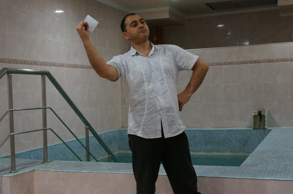 Genghis, caretaker of the mikvah at the Derbent Jewish Community Center in the Russian republic of Dagestan, striking a pose worthy of his name. (Cnaan Liphshiz)
