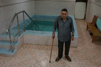 An elderly resident of Derbent, a town in the Russian republic of Dagestan, attending the mikvah at the local JCC. (Cnaan Liphshiz)