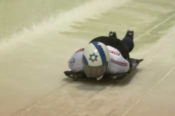 Skeleton competitor Bradley Chalupski, representing Israel, starts down the track at the men's world championships in Lake Placid, N.Y., Feb. 24, 2012. (Ken Childs)