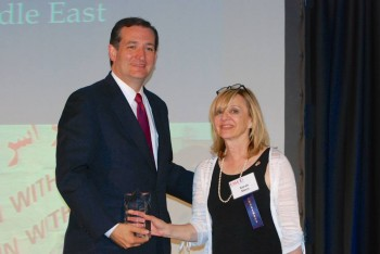 Sarah Stern, director of the Endowment for Middle East Truth, presenting the Speaker of the Truth award to Texas Sen. Ted Cruz in Washington, June 2013. (EMET)
