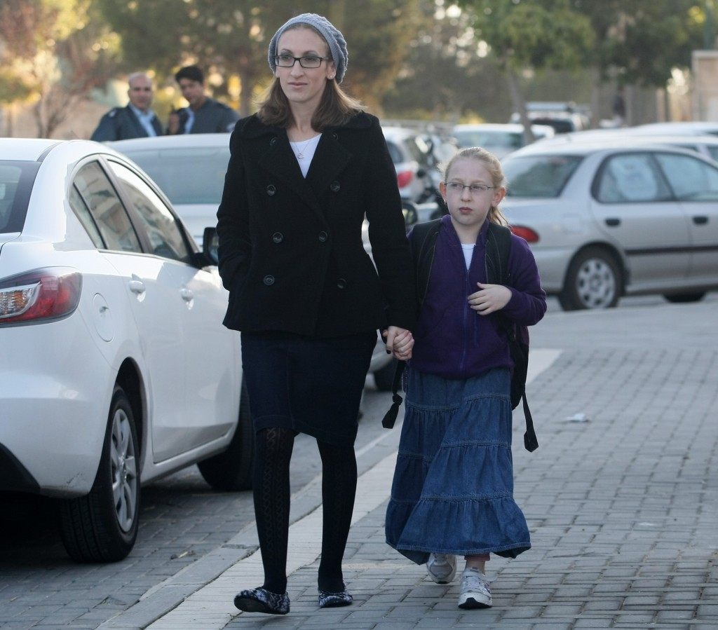 Hadassa Margolese walking her daughter Naama to school in Beit Shemesh a few days after Naama was harassed by haredi Orthodox men, December 2011.(Kobi Gideon / Flash90 / JTA)