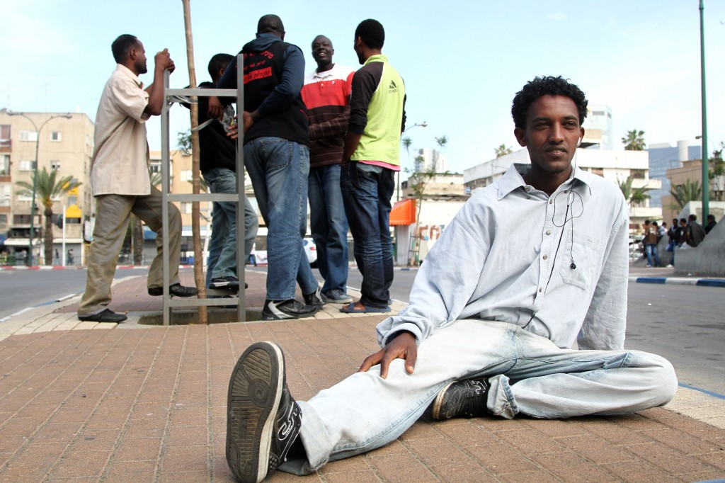JTA PHOTO: For African migrants in Israel, a life in legal limbo Sudanese and Eritrean refugees gather in the Levinski Park area in south Tel Aviv. (Nicky Kelvin/Flash90/JTA)