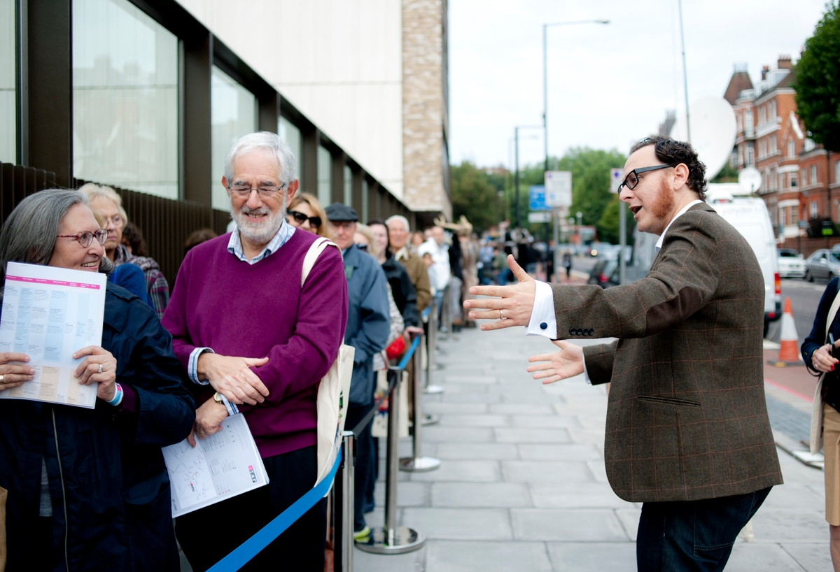 Raymond Simonson greets visitors at the opening of London's new JW3 community center. (Blake Ezra Photography)