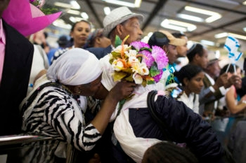New Ethiopian immigrants to Israel reuniting with their relatives at Ben Gurion Airport, Aug. 28, 2013. (Ilia Yefimovich/Getty Images/JTA)