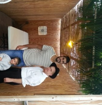 Omri Casspi of the Houston Rockets joined Chabad of Clearwater director Rabbi Levi Hodakov in a Sukkah in Clearwater, Fla.(Courtesy of Chabad of Clearwater)